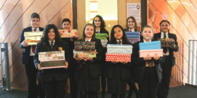 All Saints' presents gift boxes to 'Open Door Charity'