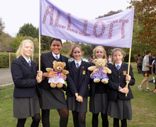 Alliott girls with alliott banner