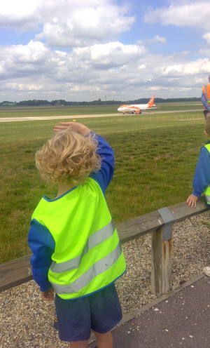 Yr 1 boy looking at planes at stansted airport