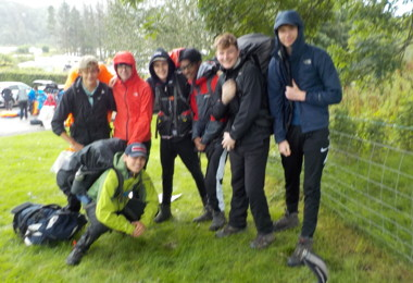 Senior School pupils in a group smiling at the camera on a Duke of Edinburgh expedition