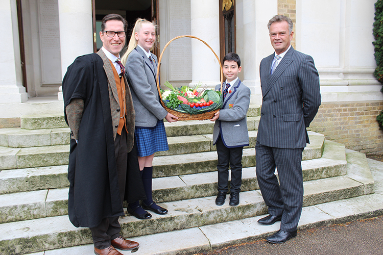Prep School head boy & girl at harvest festival 2019