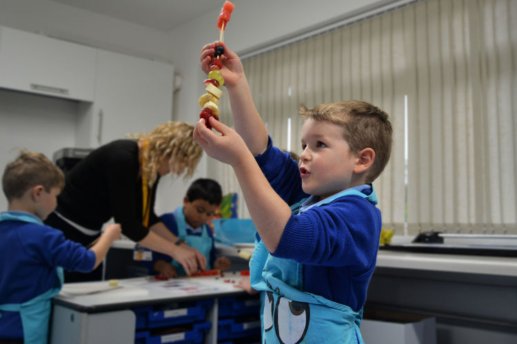 Reception boy with fruity firework kebab
