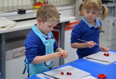 Reception pupils making fruity fireworks