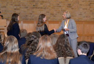 Pauline mullender hands out anti bullying bracelets