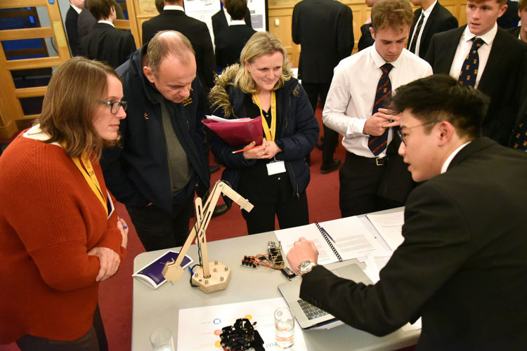 Sixth Former explaining EPQ to guests 2019