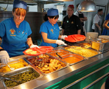 Dinner ladies serving food on meat-free Tuesday