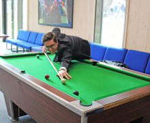 Collett House pupil playing pool