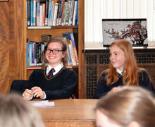Tee house team in debate v young