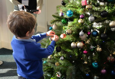 Pre-Prep boy decorating Christmas tree