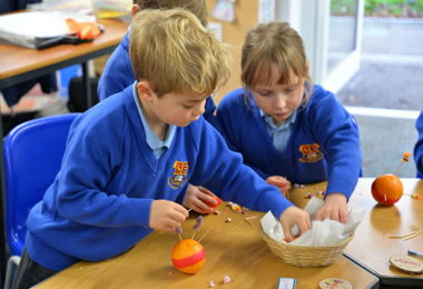 Pre-Prep pupils making Christingles together