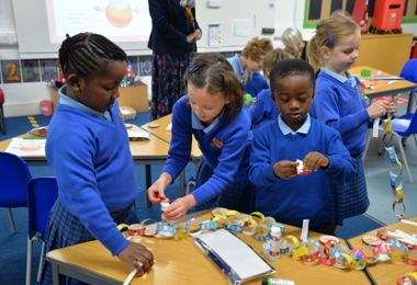 Pre-Prep pupils making Christmas paper chains