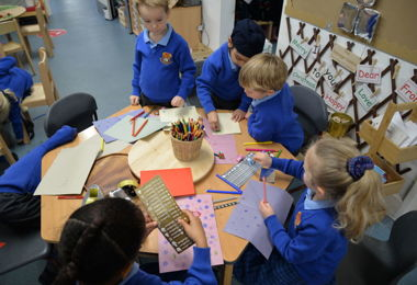 Pre-Prep pupils making Christmas decorations in group