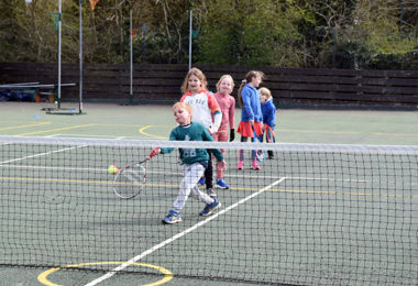 College Camp younger pupils playing tennis