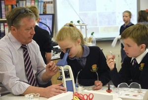 Prep School Science Pupils with Microscope