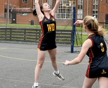 Two girls playing netball