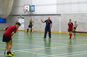 Andy Halliday coaching the U16 indoor hockey side