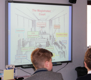 Form 2 Pupils learning about justice with Magistrate visit