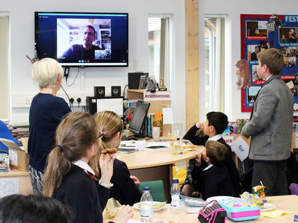F1 & 2 Pupils watching Peter Bunzl on Skype