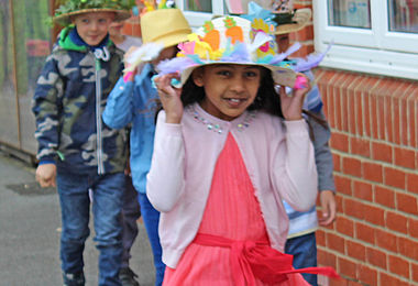 Holding onto Hat at Pre-Prep School Easter Bonnet Parade
