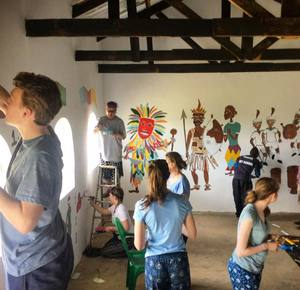 Sixth Form Students Decorating Classroom Walls on Malawi Expedition 2017