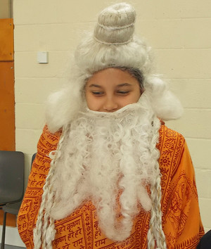 Dressed Up Pupil with Beard at Form 2 Buddhist Workshop