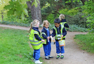 Collecting nature item on Year 1 Trip to Hyde Hall