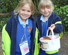 Yr 1 Girls showing off bucket of nature finds on Hyde Hall Trip