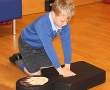 Year 2 boy reviving flat stan first aid course