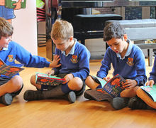 Year 2 boys enjoying flat stan first aid book together