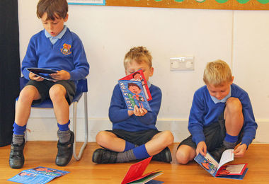 Year 2 boys reading flat stan first aid book