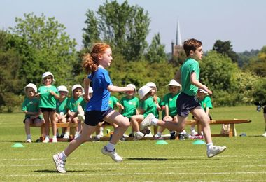 Pre-Prep Girl and Boy Running at Sports Day