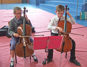 Boy and girl cellists Prep School Music Tour to Normandy