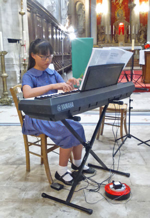 Girl on Keyboard Prep School Music Tour to Normandy
