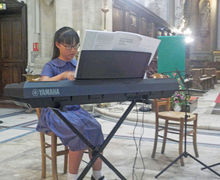 Keyboard Player in Church Prep School Music Tour to Normandy