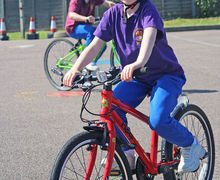 Year 2 girl on bike bikeability 2017