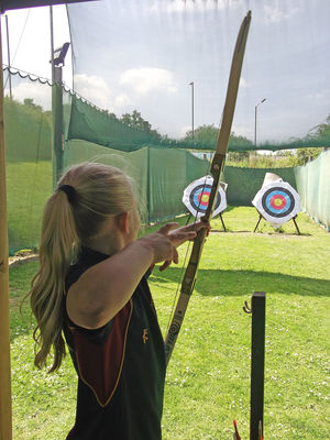 Upper shell girl archery activity afternoon