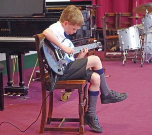 Ls music concert boy on electric guitar