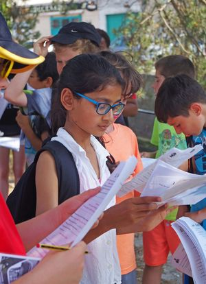 Form 1 pupils with booklets on french day trip
