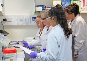 U3 girls with scientist at medimmune