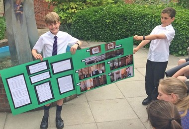 2vl Boys with plant poster for Science Project