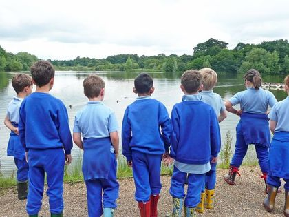 Year 2 boys looking over hatfield forest lake
