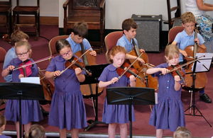 Four Girls on Violin at Year 2 Concert
