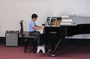 Year 2 Music Concert Boy on Piano