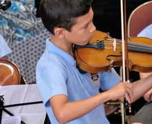 Boy on Violin Year 2 Concert