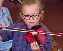 Girl Playing Violin Year 2 Concert
