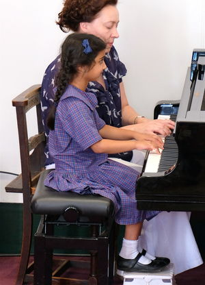 Girl Performing on Piano Year 2 Concert