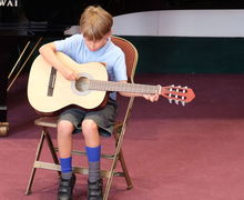 Year 2 Pre-Prep Concert Boy on Guitar