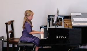 Girl Playing Piano at Year 2 Concert