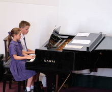 Boy and Girl on Piano Year 2 Concert