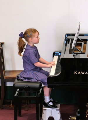 Year 2 Pre-Prep Concert Girl on Piano